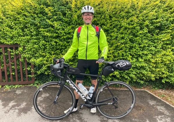 Dad is cycling the length of the country to help Castle School